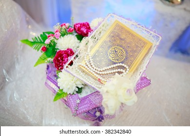 Johor, Malaysia - December 18, 2015 : Al-Quran nul Kareem is a Muslim Holy book. Malay Wedding Present give by enchanging the present between Bride to Groom.