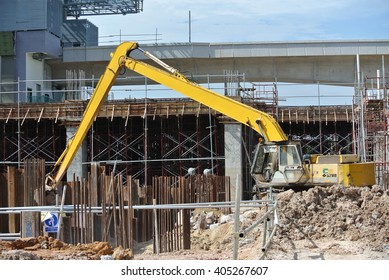 JOHOR, MALAYSIA -JANUARY 19, 2016: Excavators machine is heavy construction machine used to do soil excavation work at the construction. Powered by long hydraulic arm with basket.