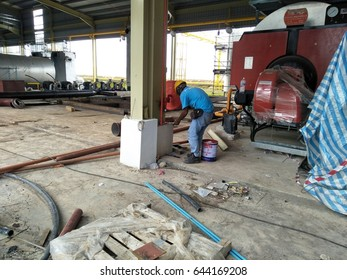 JOHOR, MALAYSIA - JUN 06, 2017 : The construction workers at the new integrated plant.