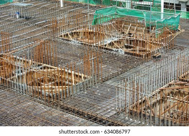 JOHOR, MALAYSIA -MARCH 18, 2017: Steel reinforcement bar at construction site. It use to strengthen concrete to form reinforced concrete. It is tied together by workers using tiny wire.