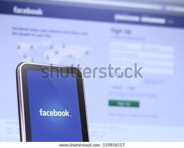 Johor, Malaysia - Sep 6, 2013: Photo of Facebook webpage on smartphone and laptop. As of today, Facebook is the largest social media network on the web, Sep 6, 2013 in Johor, Malaysia.