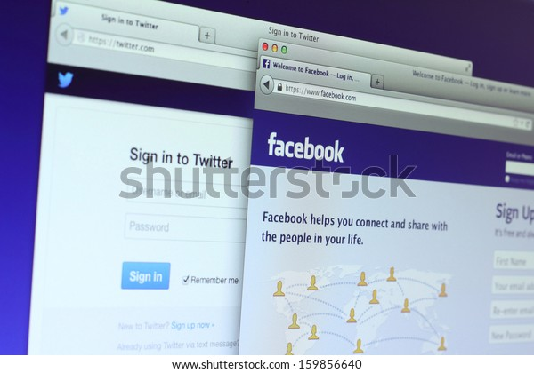 Johor, Malaysia - Sep 6, 2013: Photo of Facebook and Twitter homepage on a monitor screen. Facebook and Twitter are the largest social media network on the web, Sep 6, 2013 in Johor, Malaysia.