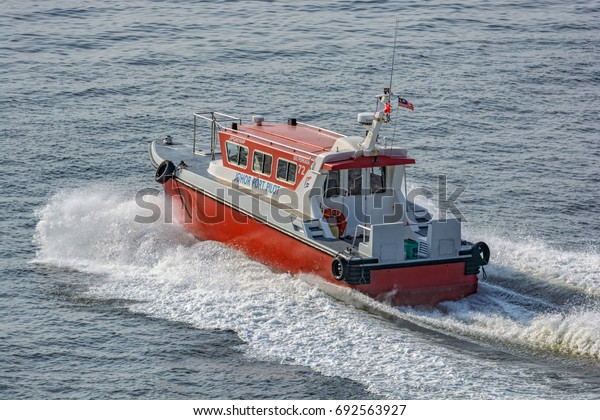 JOHOR STRAIT, MALAYSIA - March 09, 2017: Pilot boat at full speed in the waters of the Johor strait, Malaysia