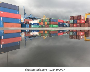 JOHOR,MALAYSIA. FEBRUARY 14,2018 : Container yard at port of Pasir Gudang. Reflection in a puddle.