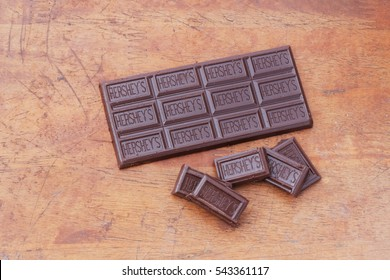 Johor,Malaysia : June 23th,2016. Hershey's chocolate on wooden background.  Hershey's Cookies and Creme Candy Bar Hershey's is an American based company founded in 1894