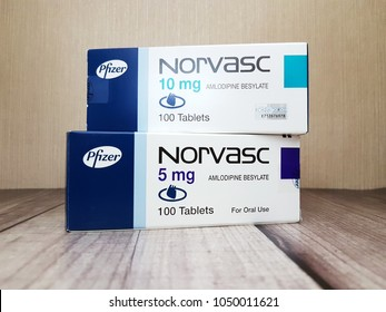 Johor,Malaysia-March 20,2018.Norvasc,hypertension medication by Pfizer is on wooden background. Pfizer is pharmaceutical company based in Manhattan