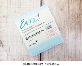 Johor,Malaysia-March 20th,2018. Ortho Evra transdermal patch box on wooden background. Evra patch is contraceptive medicine to prevent pregnancy by Janssen.