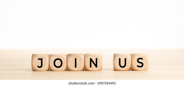 Join now word on wooden blocks on wood table. Copy space. White background