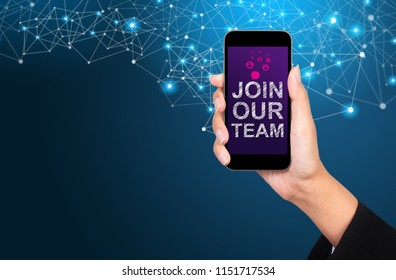Join our team concept. Join our team on smartphone screen in businesswoman hand.