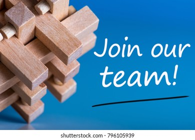 Join our team - message at blue background near macroviewed brain teaser. Hiring and new job concept