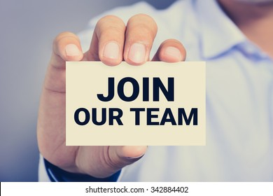JOIN OUR TEAM, message on business card shown by a man