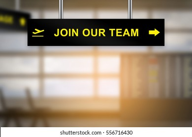join our team on airport sign board with blurred background and copy space