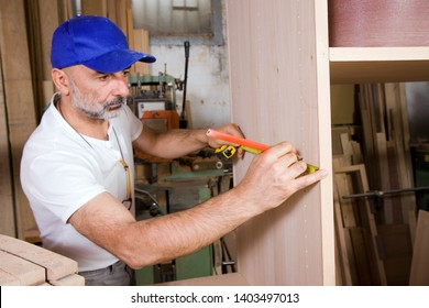 joiner building furniture in his workshop
