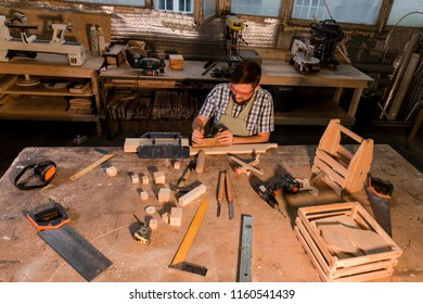 Joiner craftsman joiner makes the product in the workplace