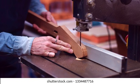 Joiner cut section of guitar neck with bandsaw