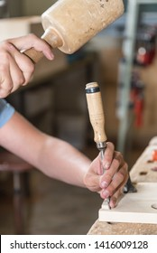 Joiner works with mallet and chisel wood - close-up