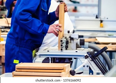 Joiner's shop. Woodworking. Carpentry. Joiner for the workflow. Joinery. Furniture production. Worker makes a cut on a wooden blank.
