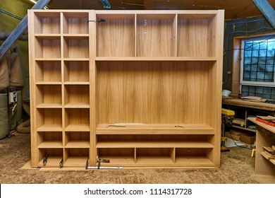 Joinery. Oak veneered mdf wardrobe in workshop. Wooden furniture. Details wood production