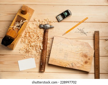 joinery tools on wood table background with business card and copy space