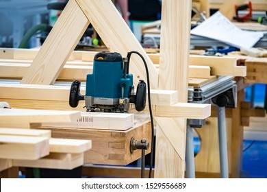 Joinery. Woodworking. Woodworking production equipment. Production of furniture to order. Woodworking equipment. Joiner's shop. Machine for sawing grooves in wood.