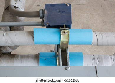 joint air condition installation on building, industrial air condition on building, blue pipe, insulation pipe, selective focus.