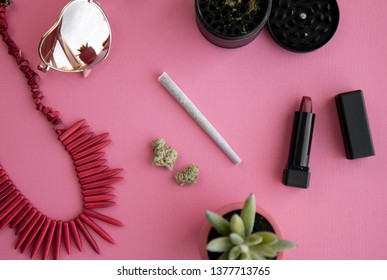 Joint and Buds on Bright Pink Background with Lipstick, Necklace, Grinder and Heart Sunglasses