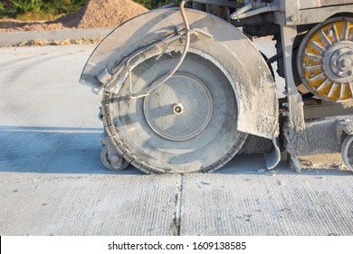 The joint cutter machine on a brushed concrete surface. Construction equipment for cutting saw slab.