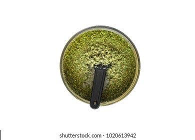 Joint and a grinder with crushed weed Leaf of cannabis, marijuana, unrolled weed on a white background top view close weed