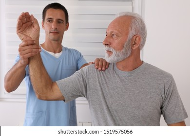 Joint Problems, Arthritis Health and Aging. Chiropractic / Osteopathy treatment, elbow joint pain. Physiotherapy for senior male patient