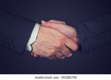 Joint venture, corporate people handshaking to form a temporary partnership by shared ownership over business undertaking