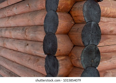 Joints of logs of a wooden house (log house) way of chopping in a bowl (oblo)
