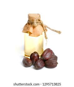 Jojoba or Simmondsia chinensis, goat nut, deer nut pignut, wild hazel, quinine nut, coffeeberry, and gray box bush. With oil.