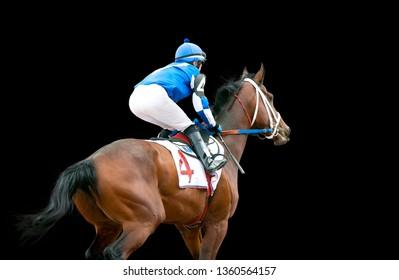 jokey on a racing horse runs to finish isolated on black background