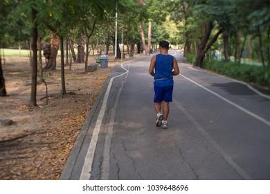 Joking man in park ( Sensitive focus )
