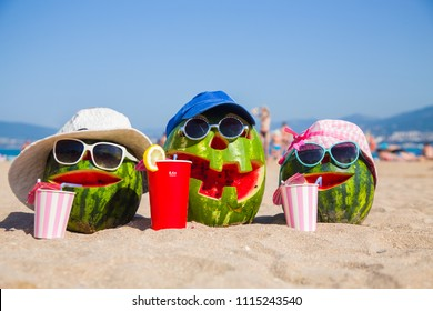 joking picture of a group of watermelons depicting a family vacation on the beach