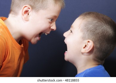Jokingly shouting brothers against blue background
