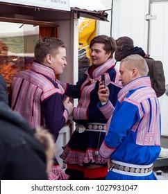 JOKKMOKK, SWEDEN ON FEBRUARY 03. Three young men take part of the Market Days on February 03, 2018 in Jokkmokk, Sweden. Dressed up for the day.