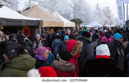 JOKKMOKK, SWEDEN ON FEBRUARY 03. View of well-dressed people move along the Market stalls on February 03, 2018 in Jokkmokk, Sweden. Cold winter day.
