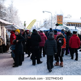 JOKKMOKK, SWEDEN ON FEBRUARY 03. View of well-dressed people move along the Market stalls on February 03, 2018 in Jokkmokk, Sweden. Cold winter day.