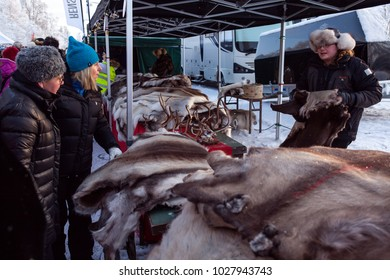 JOKKMOKK, SWEDEN ON FEBRUARY 03. View of a stand on the Market Days on February 03, 2018 in Jokkmokk, Sweden. Winter and cold conditions. Reindeer skin for sale.