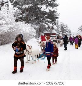 JOKKMOKK, SWEDEN ON FEBRUARY 08. View of the parade through Jokkmokk community with reindeer, traditional classics Sami dresses, tourists on February 08, 2019 in Jokkmokk, Sweden.