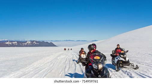 JOKLASELL, ICELAND - JULY 25,2017. Excursion on snowmobiles at Vatnajokull glacier, South-eastern Iceland, on a cloudless day in summer.