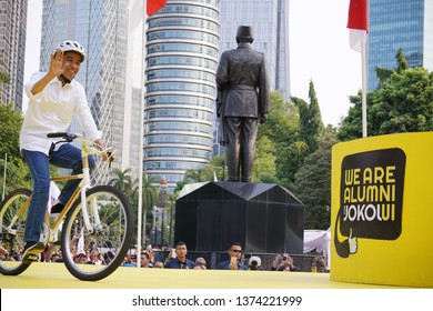 "Joko Widodo, Indonesia's President for 2014 - 2019, come to the main stage riding bicycle at ""Alumni UI for Jokowi"" event.  Location: Gelora Bung Karno, Jakarta, Indonesia. Date taken:  2019/01/12"