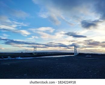 Jokulsarlon glacier lagoon bridge in Iceland at golden hour.