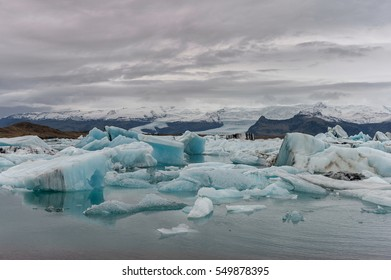 Jokulsarlon Glacier Lagoon in Iceland. Cloudy Sky, Floe and Icebergs