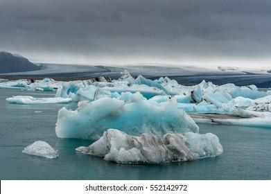 Jokulsarlon Glacier Lagoon in Iceland. Cloudy Sky, Icebergs in Water.