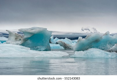 Jokulsarlon Glacier Lagoon in Iceland and Mountain in Background. Cloudy Sky.