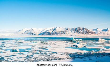 Jokulsarlon, the glacier lagoon in Iceland near by Reykjavik, There are many glaciers  floating in the lagoon and the snow mountain in background. it is blue tone Icelandic background.