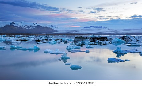 Jokulsarlon, glacier lagoon in Iceland at night with ice floating in water. Cold arctic nature landscape scenery. Ice melting.