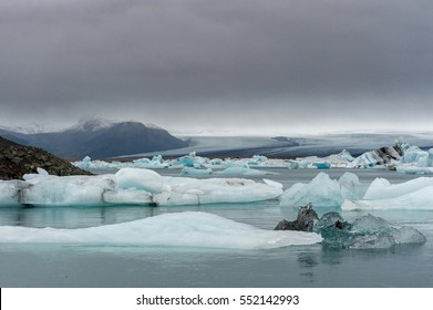 Jokulsarlon Glacier Lagoon in Iceland and Water, Mountain in Background
